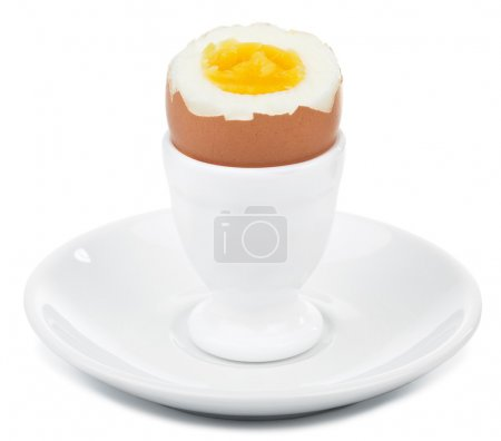 Boiled egg in egg cup isolated