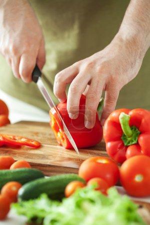 Man cutting vegetables...