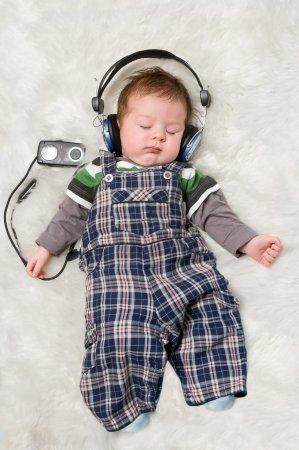 Newborn kid listening music