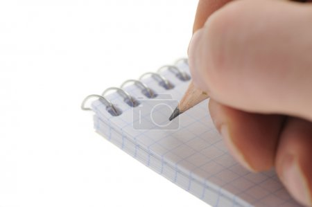 Photo pour Main avec un crayon. Un crayon graphite et un carnet - image libre de droit