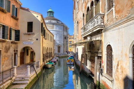 Old houses and small canal in Venice, Italy.