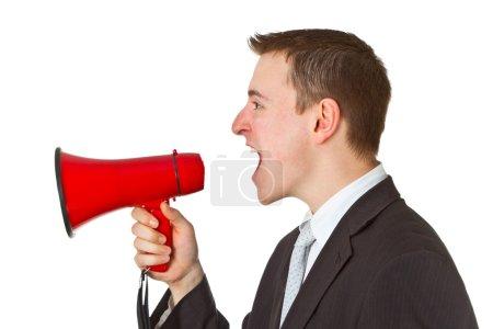 Businessman yelling through a megaphone