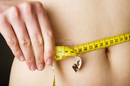 Photo for Measuring the waist - Royalty Free Image