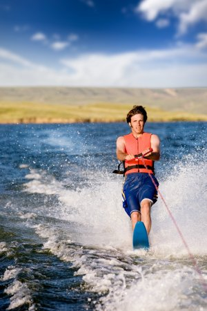 Photo for A man water skiing on a lake - Royalty Free Image