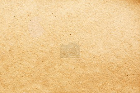 Warm soft sand background texture with fine detail...