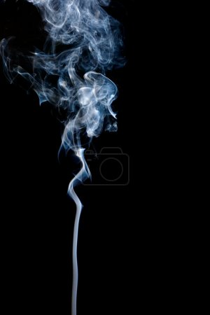 Photo for A stream of smoke slowly rising - Royalty Free Image