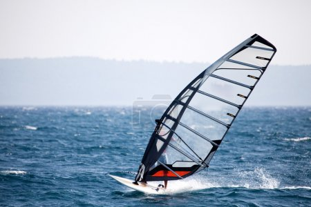 A wind surfer on the ocean...