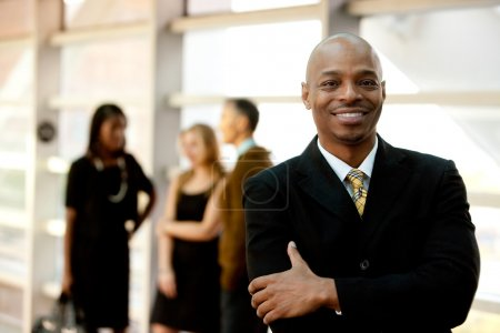 A happy black business man with in the background