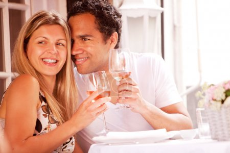 Photo for A happy couple in a outdoor restaurant on a date - Royalty Free Image