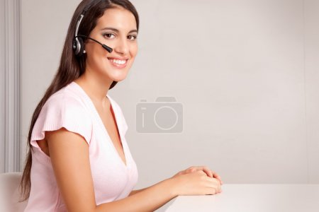 Photo for A female on a hands free phone - friendly call center - Royalty Free Image