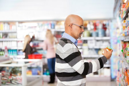 Mature man shopping in the supermarket