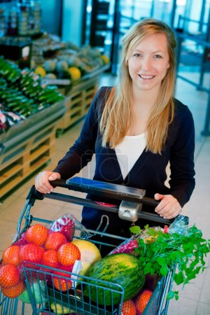 Photo for A portrait of a happy female shopper in a supermarket - Royalty Free Image
