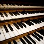 An old pipe organ keyboard in a church...