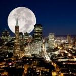 A full moon over a urban metropolis...