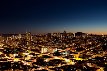 Photo for A view of a city at night with a sunset on the horizon - San Jose - Royalty Free Image