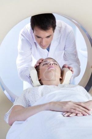 Woman going through MRI scan