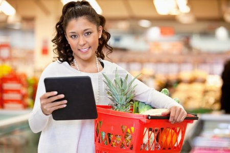 Woman with Tablet PC Shopping List