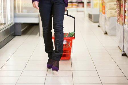Woman Walking with Shopping Basket