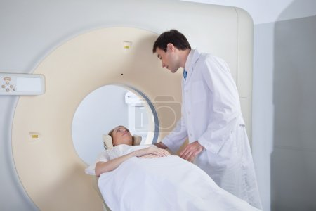 Young woman receiving CT scan