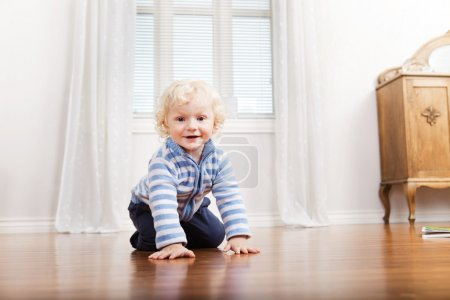 Child Crawling on Floor