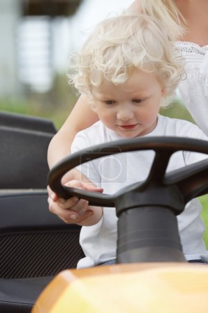 Young Boy Holding Steering Wheel