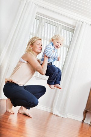 Mother playing with boy