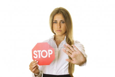 Photo for Close-up of an attractive young business woman in one hand a STOP sign, the other shows STOP gesture. isolated - Royalty Free Image