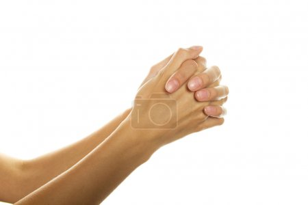 Photo for Close-up of woman hands folded in prayer. Isolated on a white background - Royalty Free Image