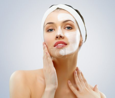 Photo for Beauty women getting facial mask - Royalty Free Image