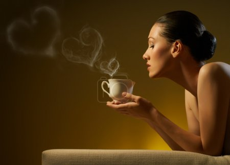 Photo for Woman with an aromatic coffee in hand - Royalty Free Image