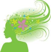 Jarní žena s dlouhými vlasy s květinami