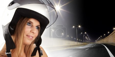 Sexy woman with a white motrcycle helmet and surpr...