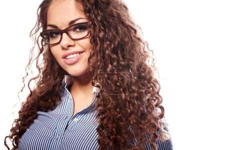 Portrait of a successful businesswoman in glasses a white backg