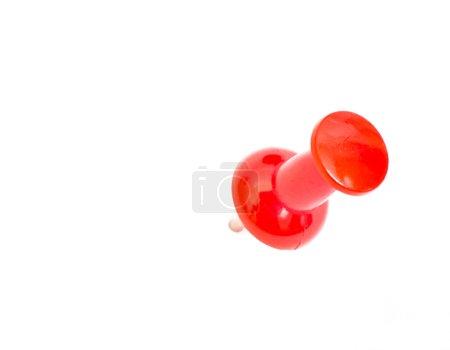 Push pin on white