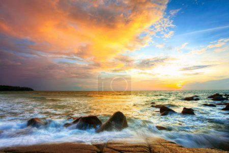 Photo for Tropical colorful sunset at the stones beach. Thailand - Royalty Free Image