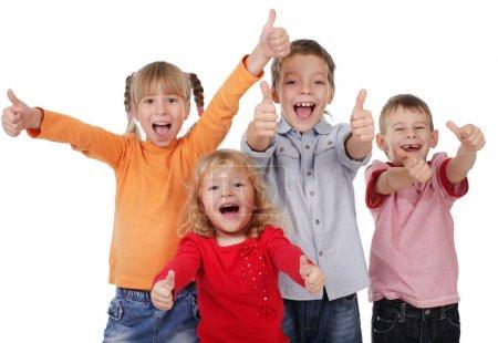 Photo pour Enfants heureux montrant pouce vers le haut - image libre de droit