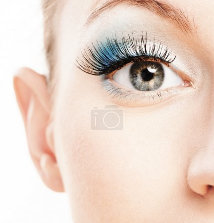 Photo for Eye and nose of beautiful young woman close up, soiled by green cosmetics. - Royalty Free Image