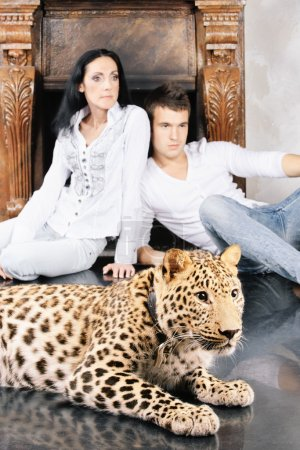 Mature woman and young man with spotty leopard