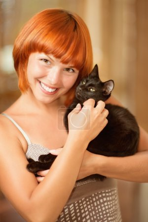 Woman with black cat.