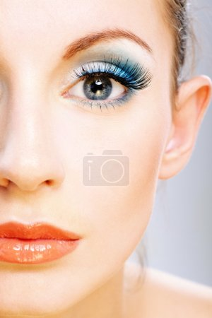 Photo for Half of face beautiful young woman with bright faultless make-up. - Royalty Free Image