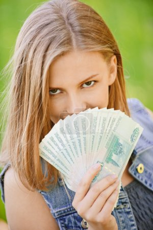Woman with Russian roubles