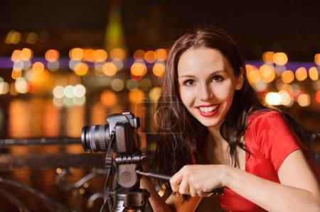 Woman photographs night landscape