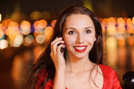 Woman talks on cellular telephone