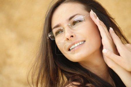 Portrait of young beautiful woman wering eyeglasses