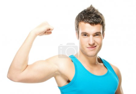 Photo for Portrait of young handsome dark-haired man wearing blue t-shirt, holding his arm up to show how strong he is against white background. - Royalty Free Image