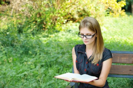 Young fair-haired woman reading book