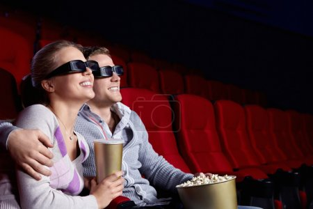Photo for Couple in love 3D glasses in cinema - Royalty Free Image