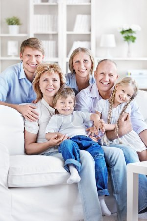 Photo for Happy family with children and grandchildren at home - Royalty Free Image