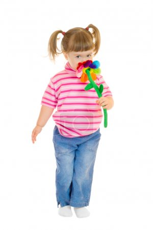 Photo for Little girl play with toy flower isolated - Royalty Free Image