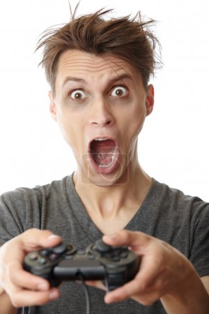 Photo for Crazy man in trouble playing video game using joystick - Royalty Free Image